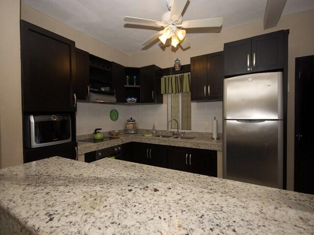 Open kitchen with granite breakfast bar.