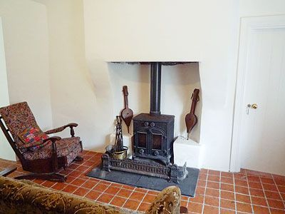 Cosy sitting room with energy efficient wood burning stove. perfect after a long day site seeing.
