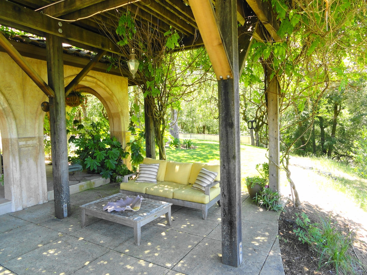 Wisteria covered Arbor - a nice comfortable retreat
