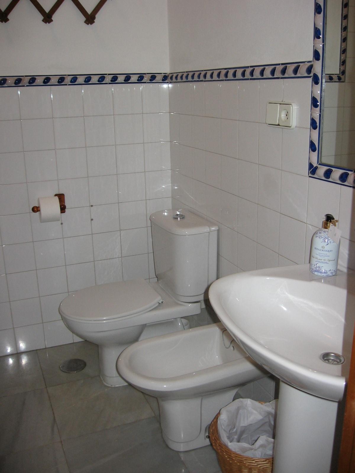 full en suite bathroom with bath tub on first floor