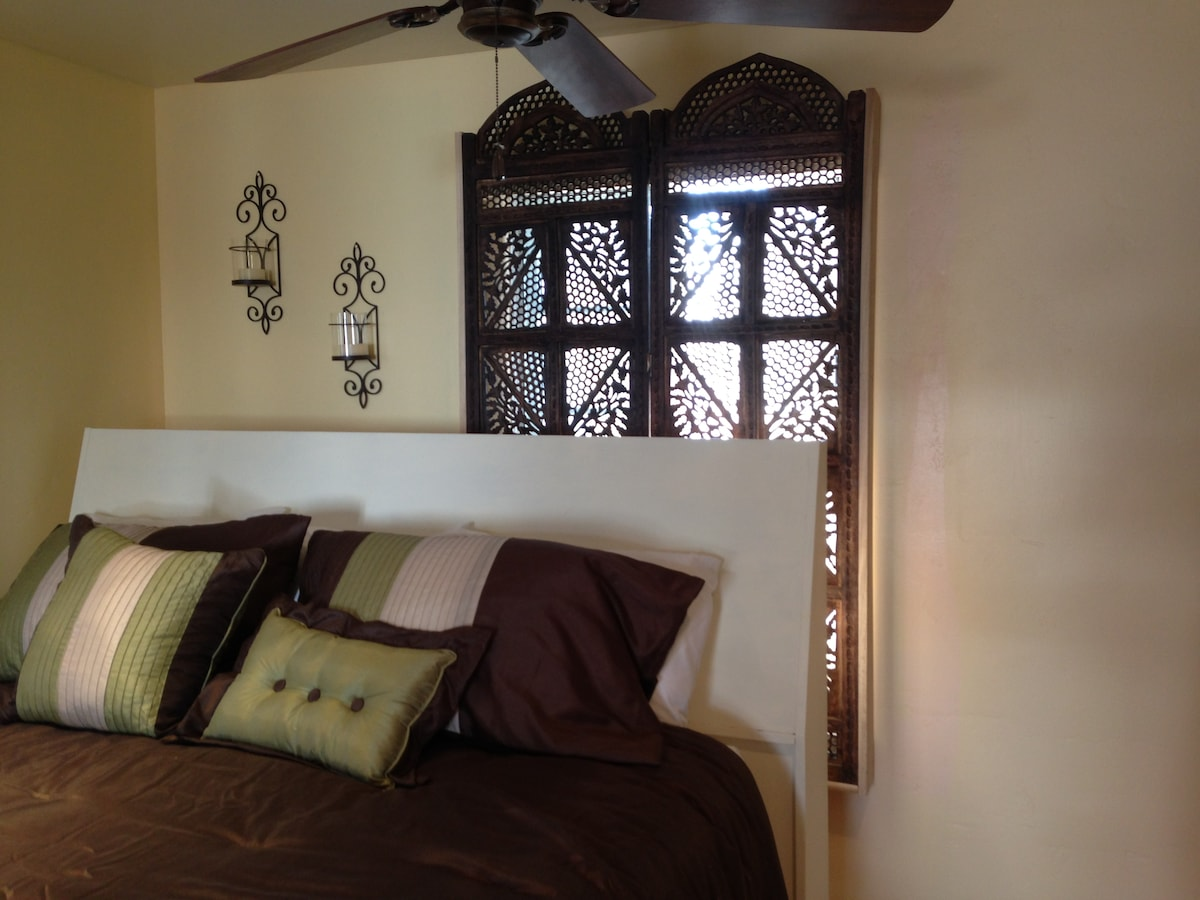 Bed & windows to outside