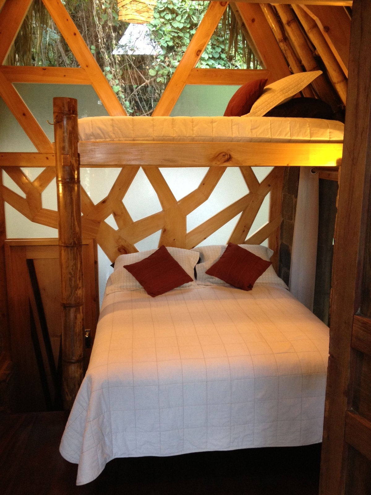 Queen size bed with twin bunk in standard bungalow.