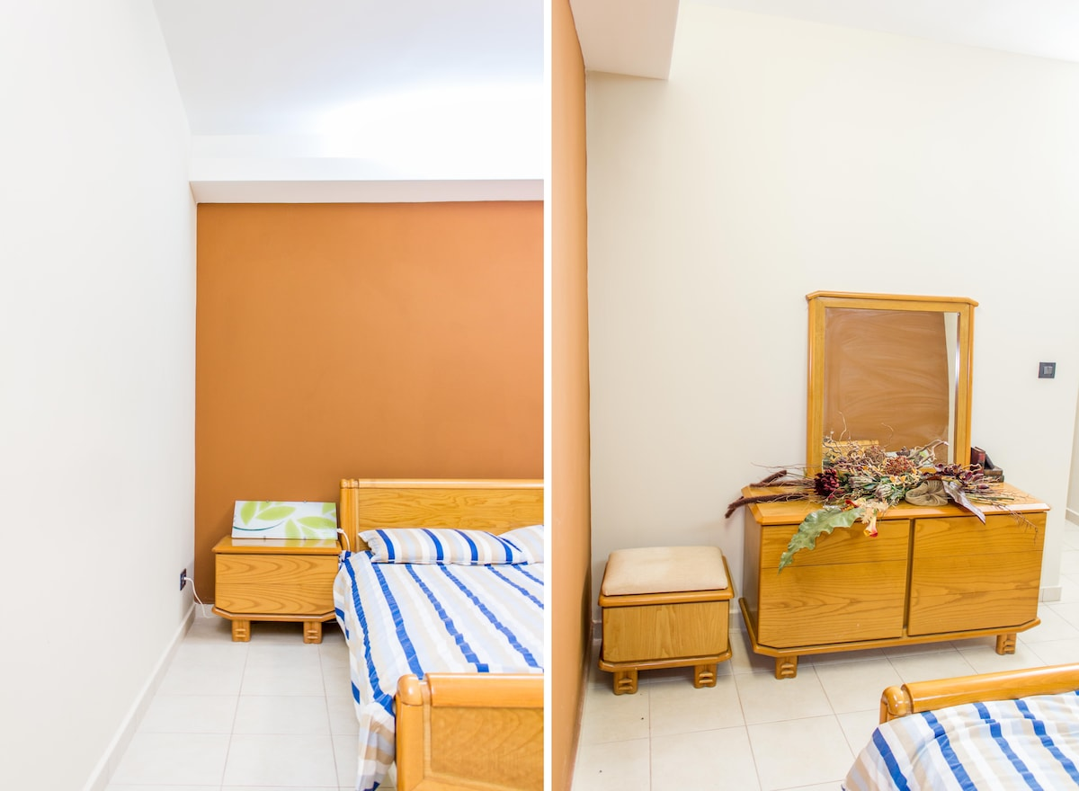 Spacious room with a large bed and free internet access