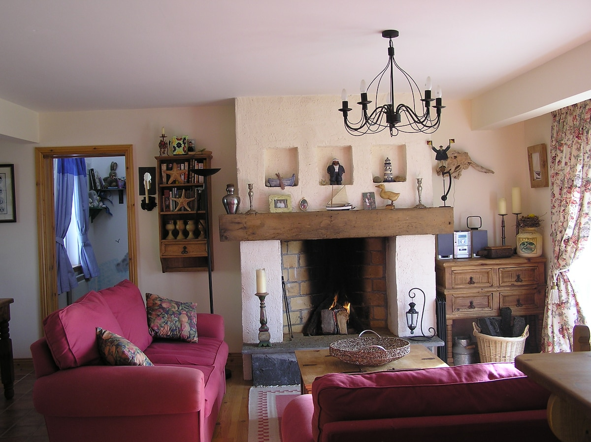 Large traditional open fire, surrounded by comfortable seating and overlooking Garden.
