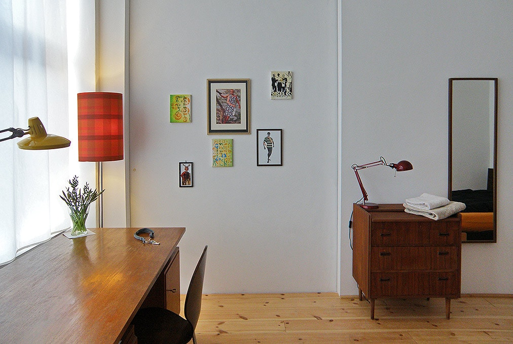 The room features regularly exchanged art installations and vintage design.