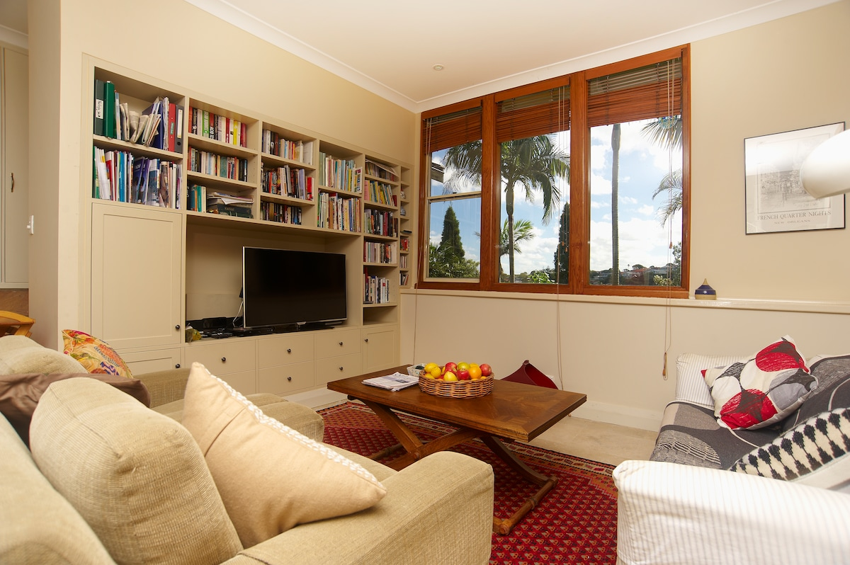 Spacious lounge area with large TV and DVD