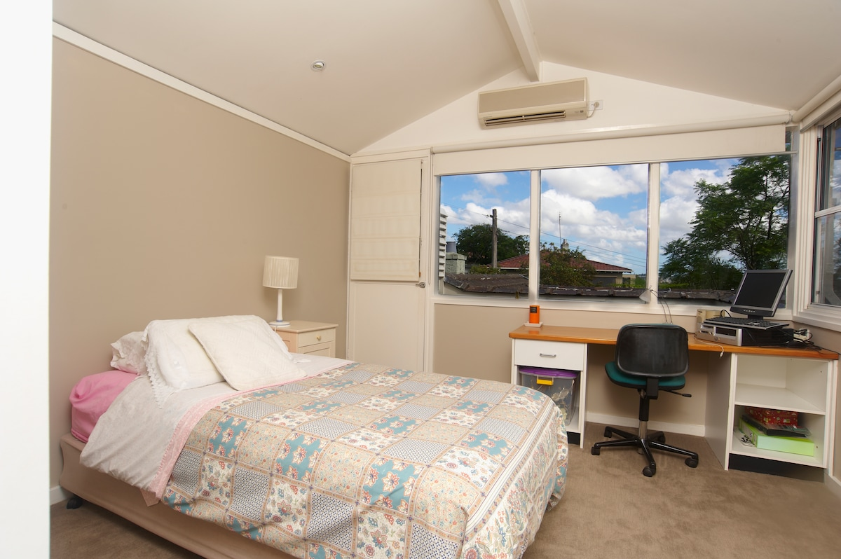 Bedroom 1 with King Size single, quality linen and private deck with views