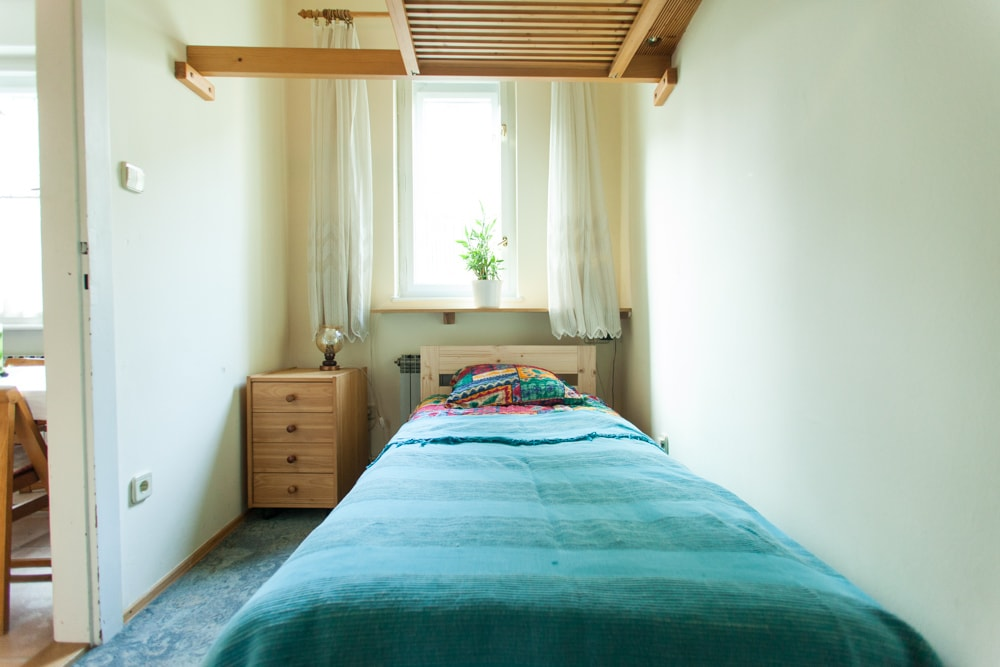 Small bedroom with one single bed and one bunk bed. Ideal for two children.