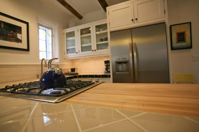 Butcher block counter top and Electrolux appliances.