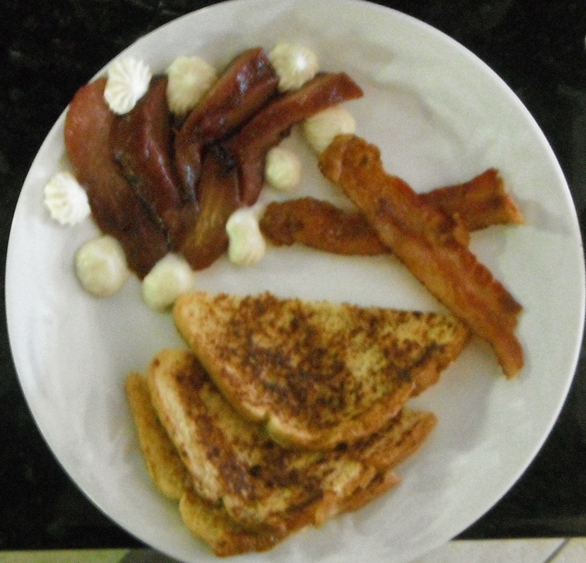 French toast, Pears, cooked in wine and spices with marscarpone cheese and bacon.
