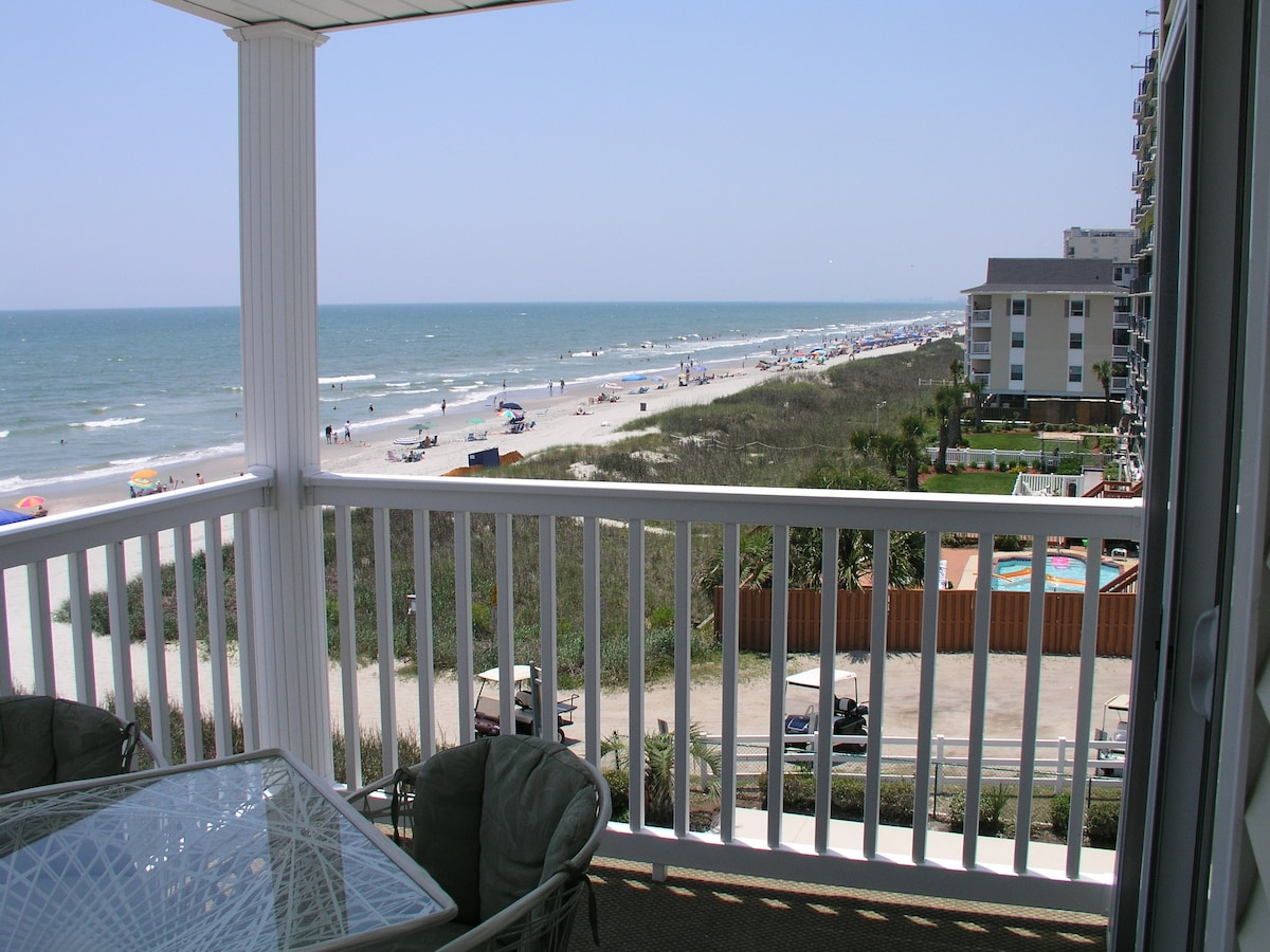 Looking south down the beach.  At night you can even see the Myrtle Beach SkyWheel all lit up!