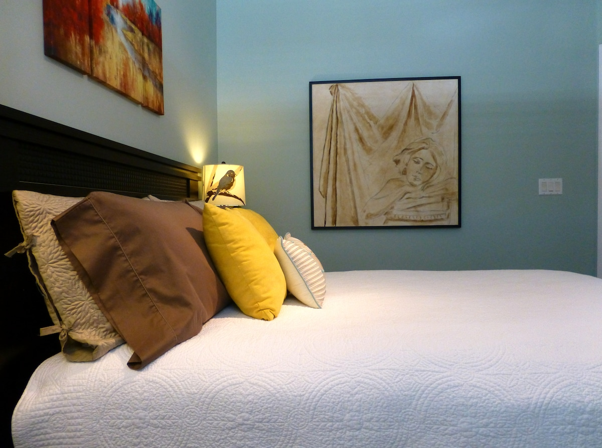 To ensure a good nights rest the bed is made with richly textured cotton coverlet and shams along with sateen sheets.