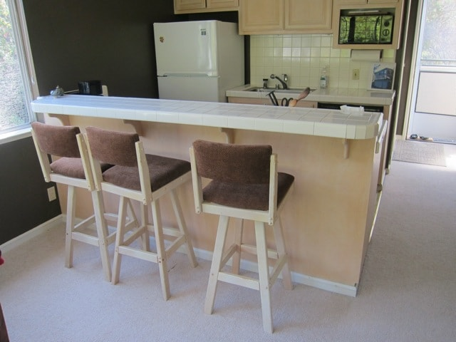 Barstools for others to visit while the cook is in the kitchen :)
