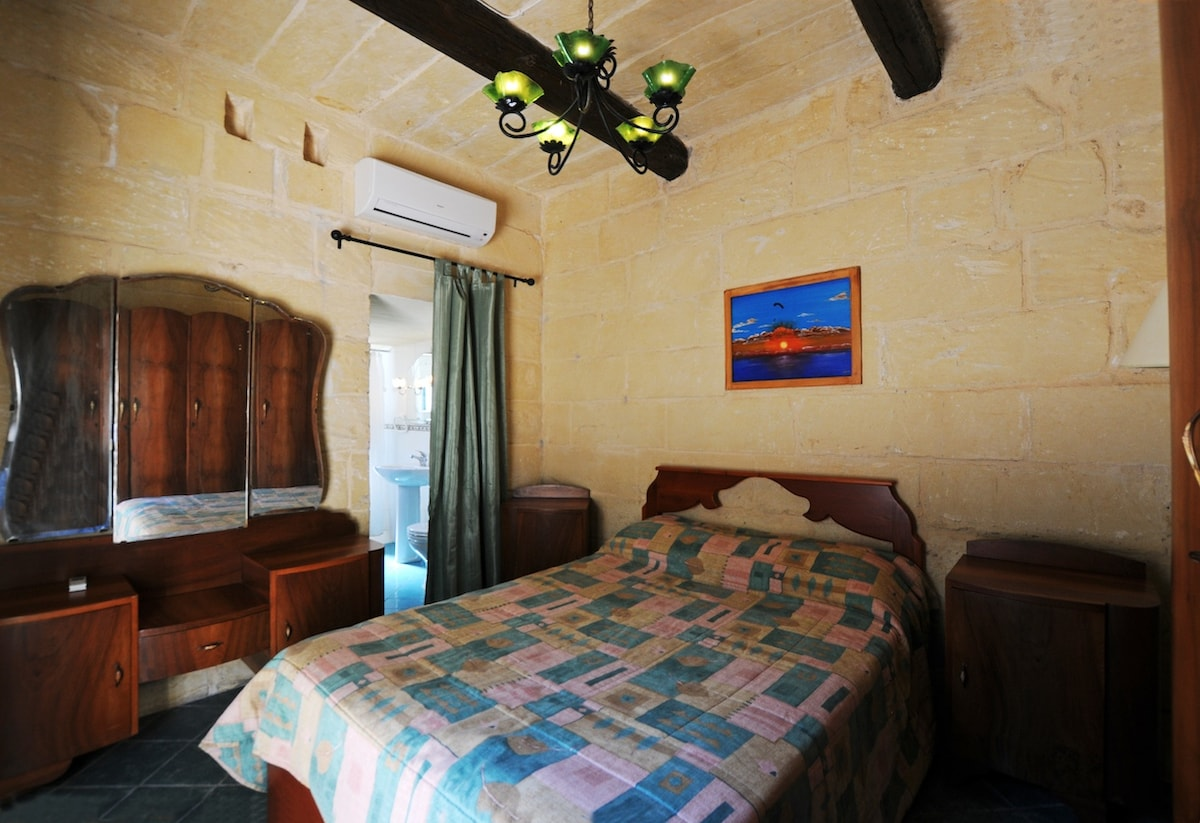 bedroom 1 with en suite bathroom and optional air conditioning