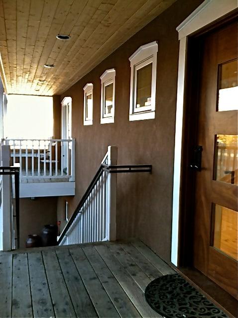 Front door, stairway and porch above Dona Luz