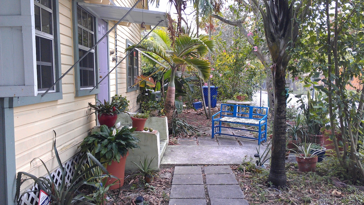 Front garden view with lush vegetation.