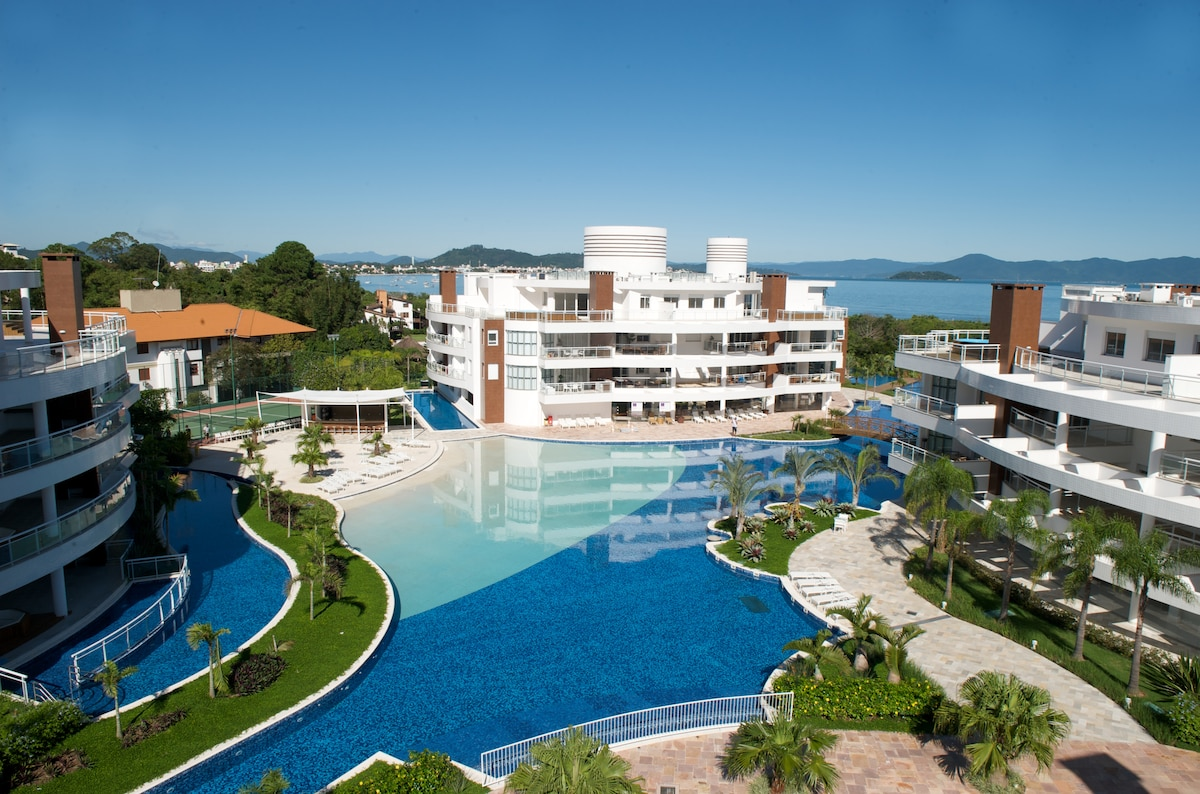 Stop searching this is your best option to  in Floripa!  This modern ocean front condo is luxuriously furnished and securely located in the island's most exclusive private resort community of multi million dollar condos.  Check out all the fotos!