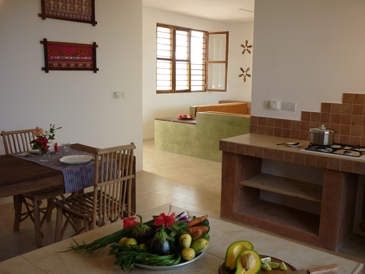 Kitchen and dining area... watching on the spacious living room