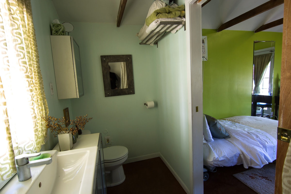 Bathroom with view into sleeping area