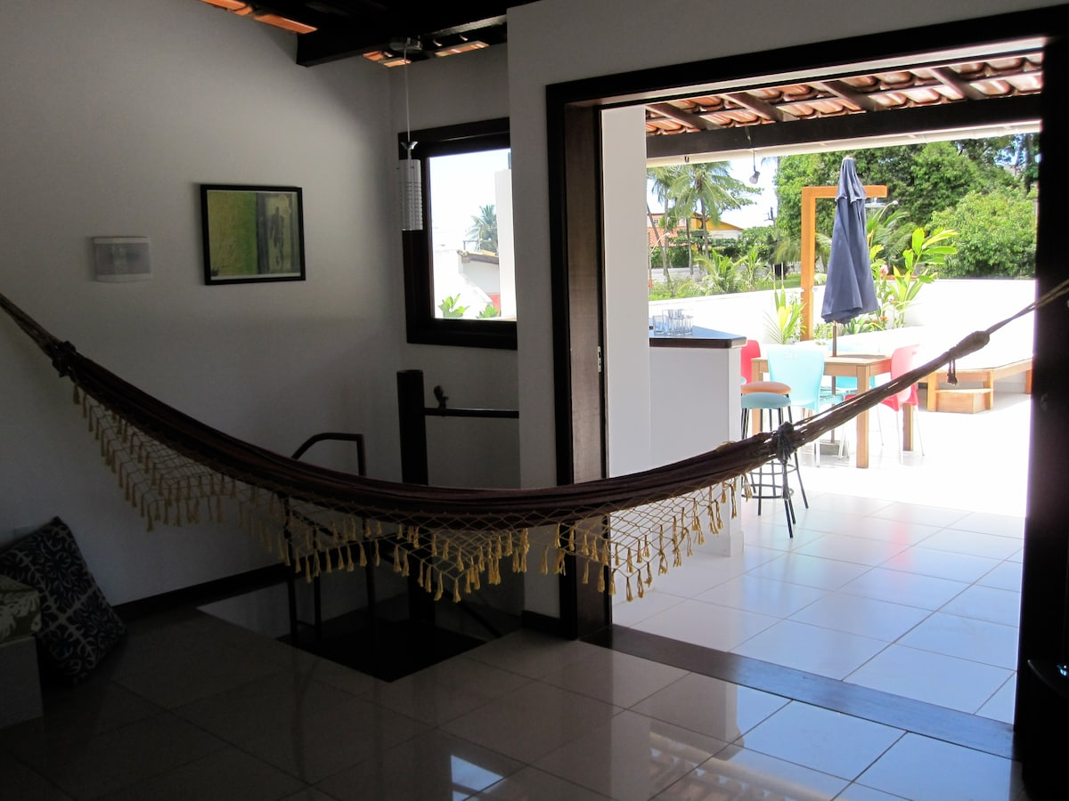 Upstairs living room with hammock and view of the terrace