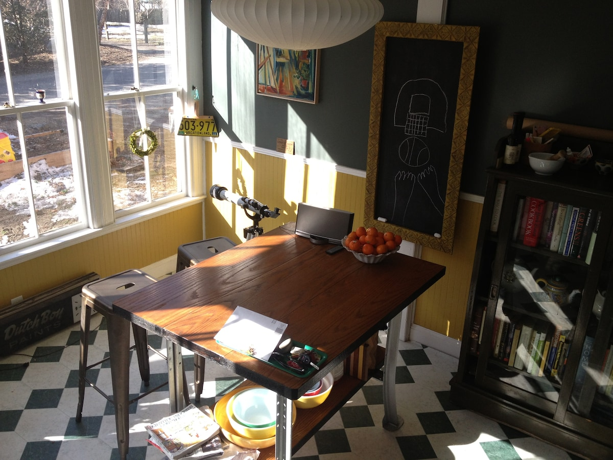View of the sunny breakfast bar at the end of the kitchen. Good chopping/hanging spot!