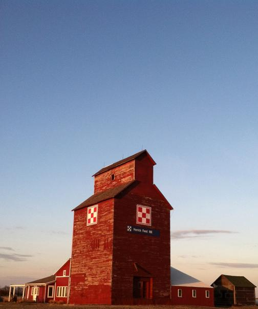 Nostalgic, weathered grain elevator.  You'll sleep in a bed in the renovated shed!
