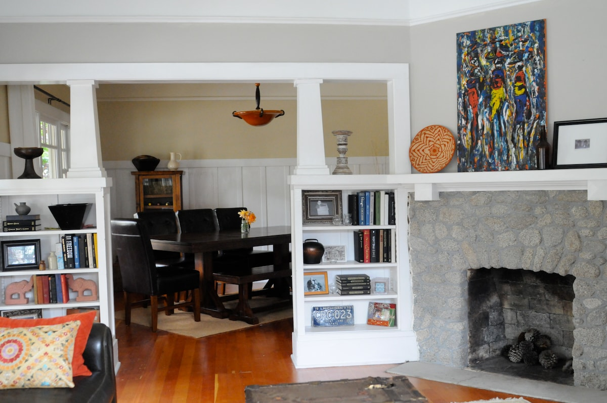 Open living space with Craftsman features throughout the home