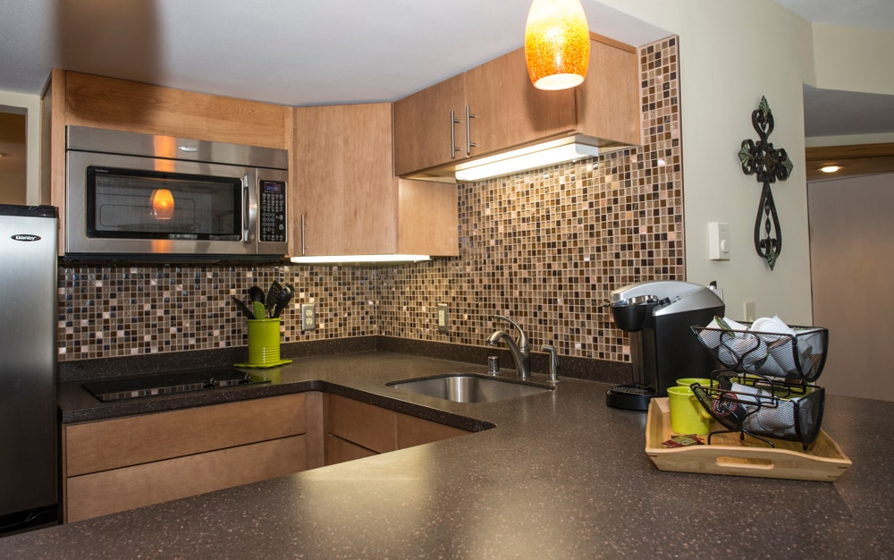 Kitchen features all dishes, utensils and linens.  Convection microwave, fridge/freezer, dishwasher and cooktop stove.