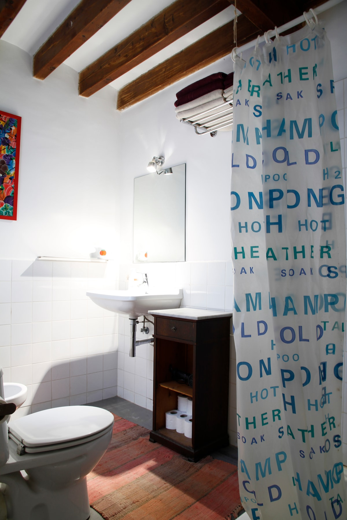 Bathroom with shower. Extra towels and hair dryer included.