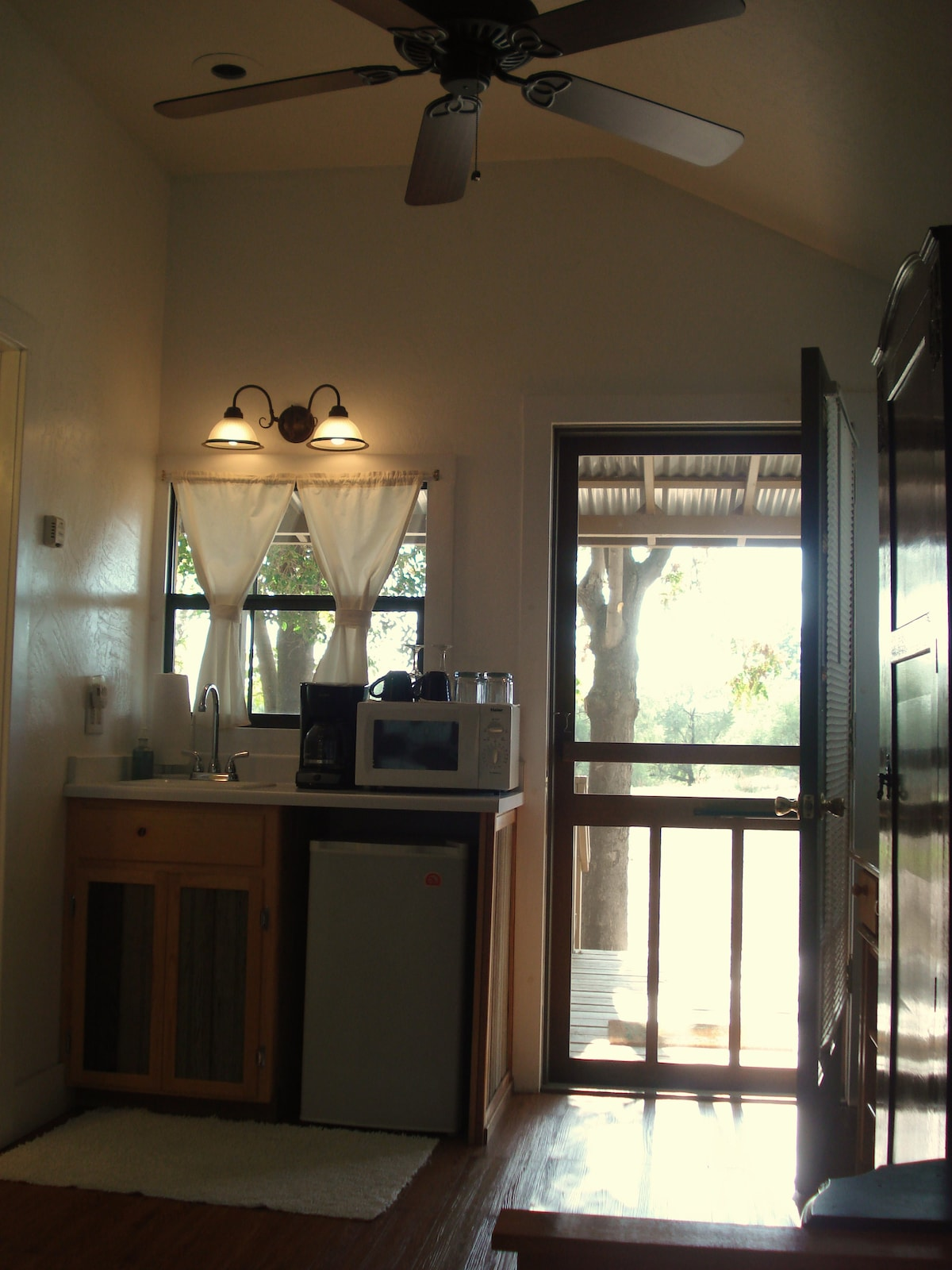 Your private kitchenette includes a sink, mini refrigerator, microwave, coffee maker, tea, fresh fruit and muffins.