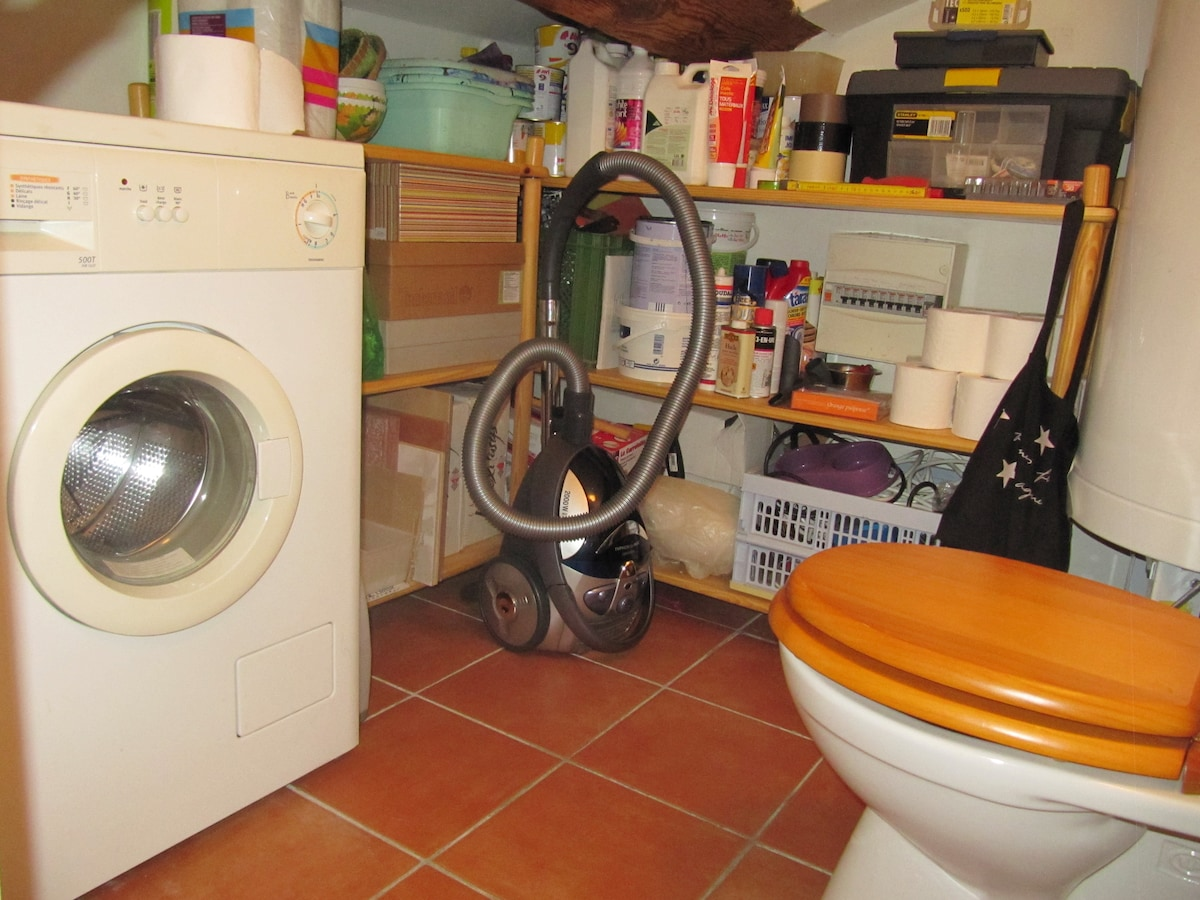 Next to the kitchen you also have a small storage area with a toilet and washing machine