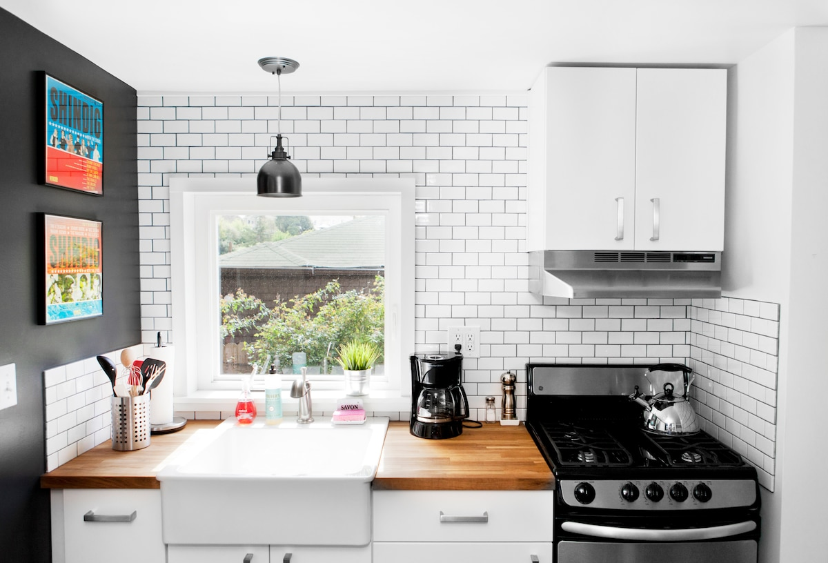 Brand new kitchen with subway tile, butcher block counters and new gas stove/oven.