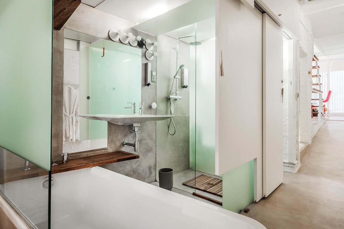 bathroom with bathtub and shower (you can close the door)
