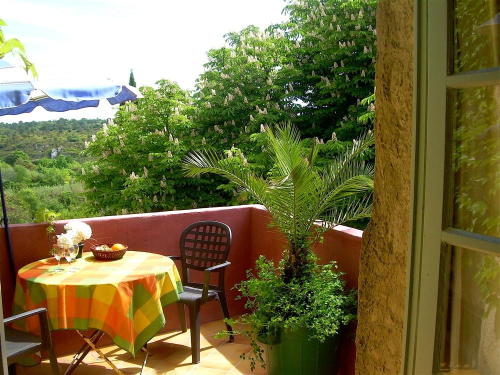 Terrace from kitchen door with views over valley de l'Eure