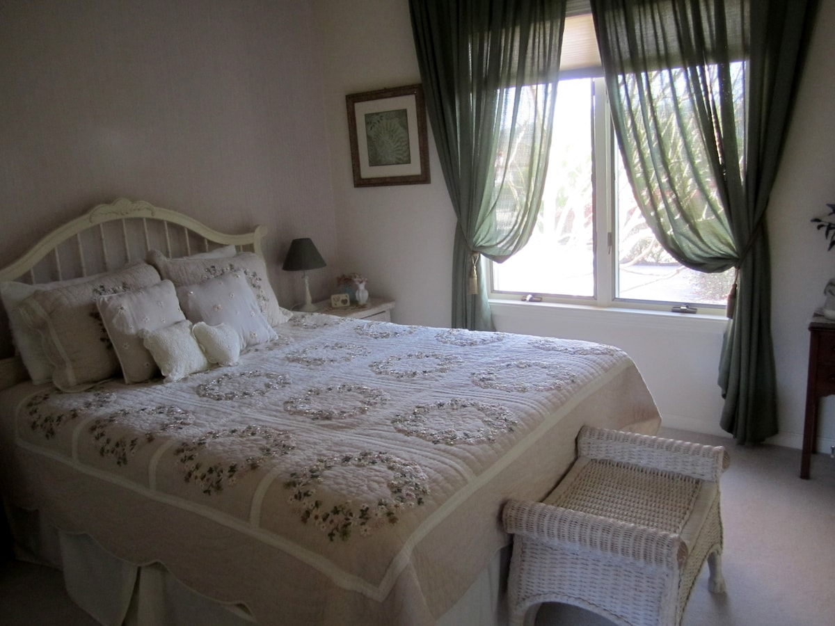 Private queen bedroom with adjoining full bathroom.