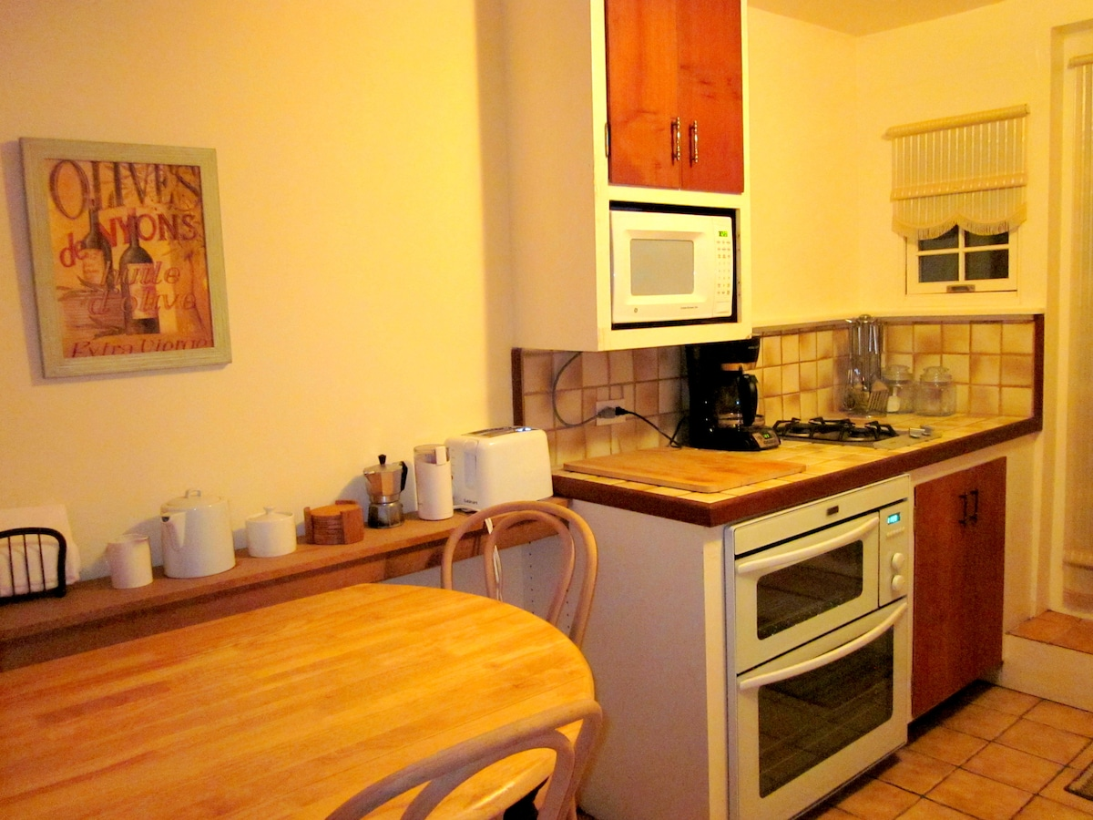 Fully equipped kitchen with 2-burner gas stove.