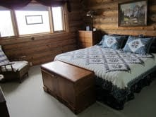 King bed with view of mountains and adjoining bathroom!