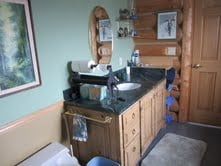 Bathroom adjoining the king bedroom with  shower..