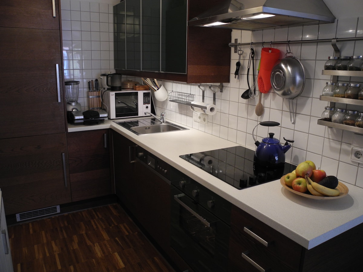 Fully equipped kitchen with stove, refregirator, pots and pans, dishes, microwave etc.