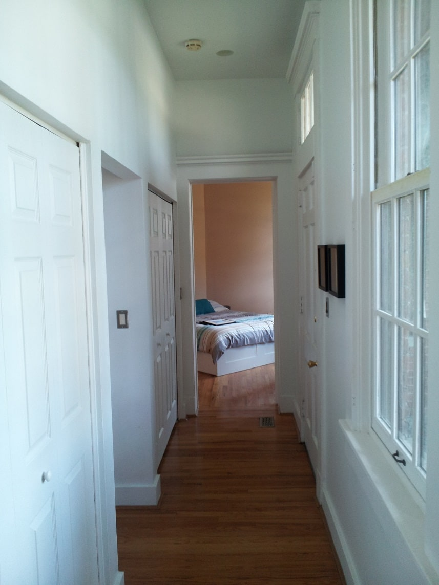 Hallway leading to the first floor bedroom.  Large windows allow a lot of natural sunlight