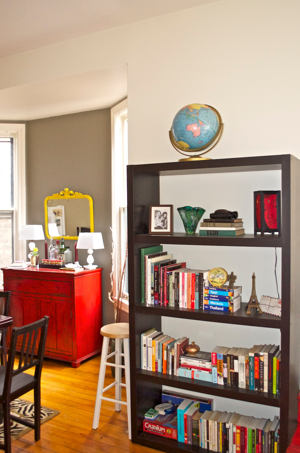 Bookcase and bar, complete with haunted vintage mirror from a New Orleans estate sale!