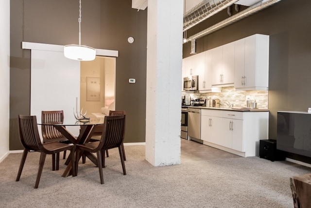 Stylish dining set adjacent to fully equipped high end kitchen