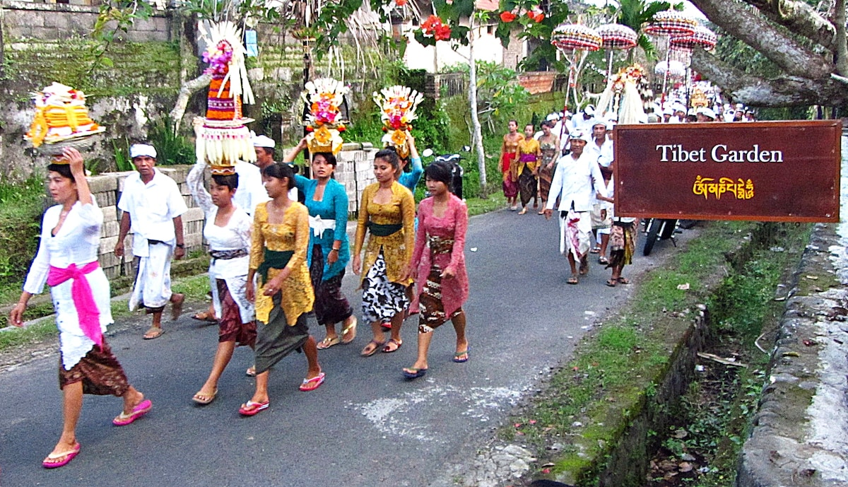 Balinese ceremony passing the main road of the village and in front of the house. Ceremonies may happen any time, ask Ibu Kadek for more details.