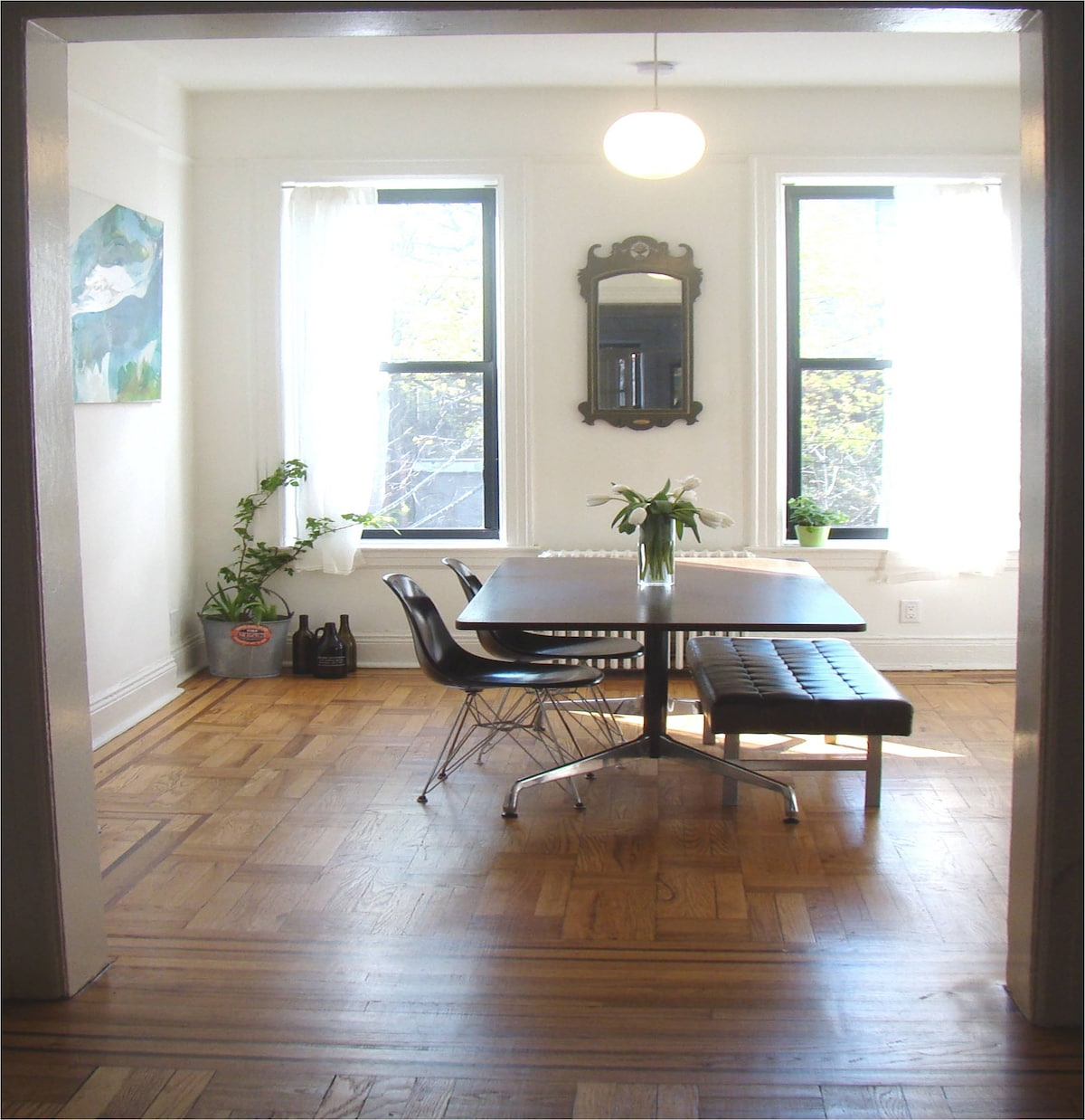 Sun-filled dining room with mid-century designer furniture