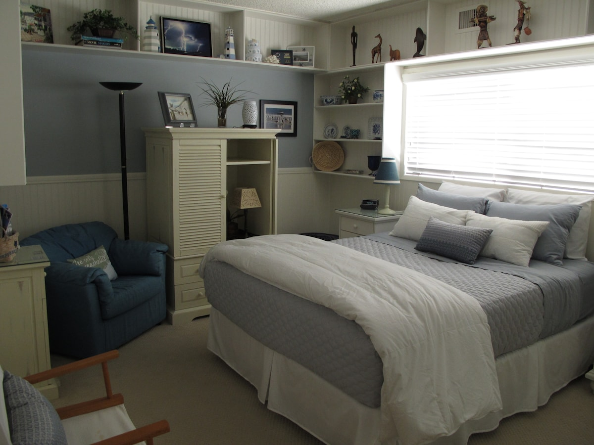 Guest room with queen size bed.  Bathroom is connected.