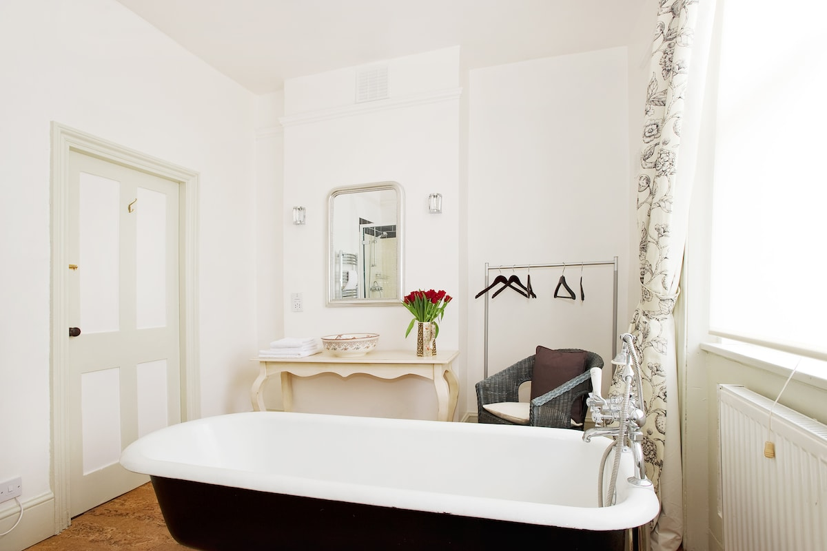 Take a long soak in the beautiful free-standing bath tub