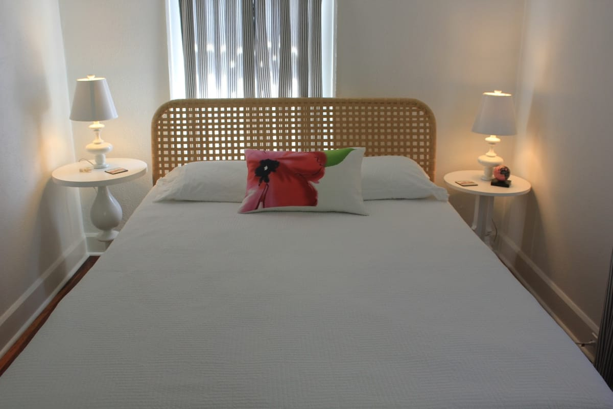 Bedroom features queen bed with luxury pillow top mattress and fresh linens.