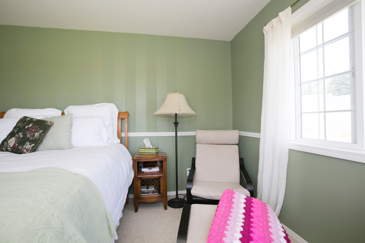 Our guest rooms are at the opposite end of the house from our room. The Vineyard View room has a chair for watching movies or reading.