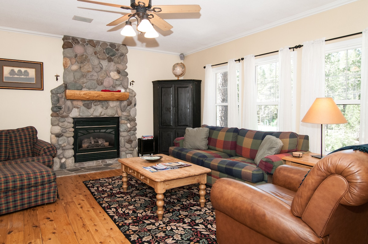 Big comfy living room with gas fireplace.