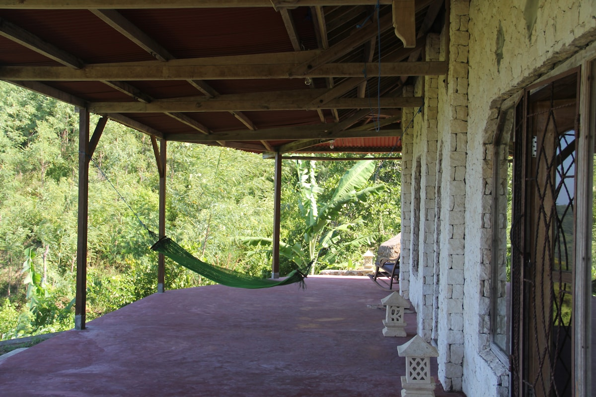 Guests like to read,gaze out to sea and doze off in the hammock and rocking chairs.